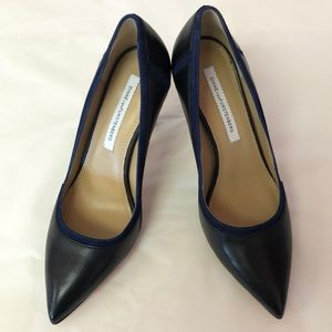 DVF Violetta black pumps w/ navy suede trim